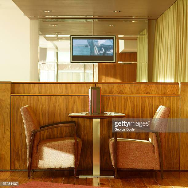 Side view of table and chair in hotel bar