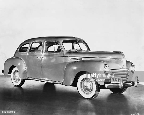 Side view of the 1940 Chrysler Royal 6 sedan automobile which has 108 horsepower and a wheelbase of 122 and a half inches