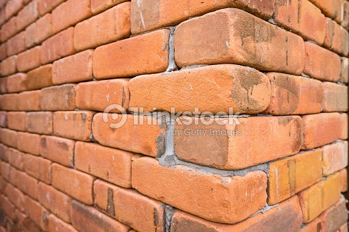Side View Of The Grunge Red Brick Wall Background Stock Photo