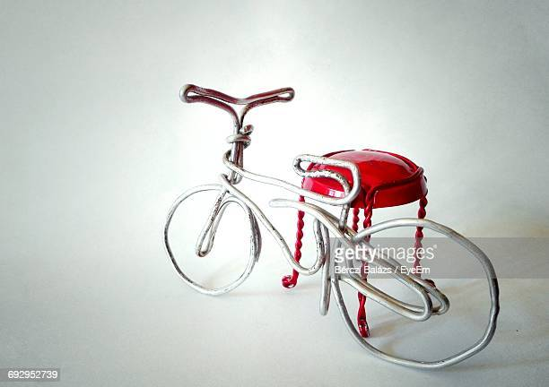 Side View Of Toy Bicycle Over White Background