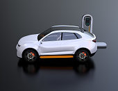 Side view of white electric SUV car charging in charging station. 3D rendering image.