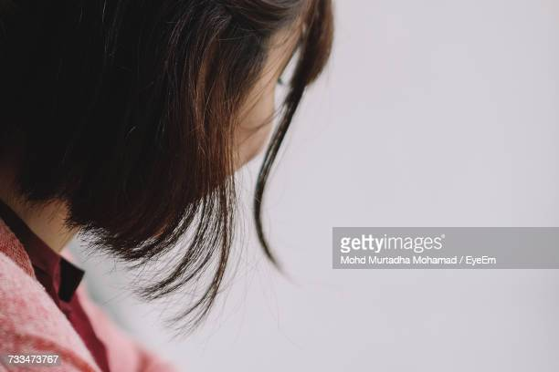 Side View Of Woman Against Wall