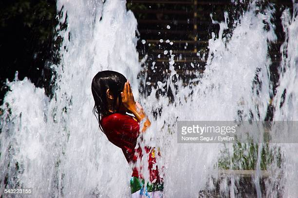 Side View Of Woman Bathing In Fountain