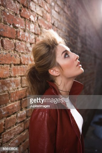 side view of woman looking up stock foto getty images. Black Bedroom Furniture Sets. Home Design Ideas