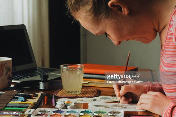 Side View Of Woman Painting Easter Bunny