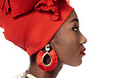 side view of young african american woman in wire head wrap isolated on white