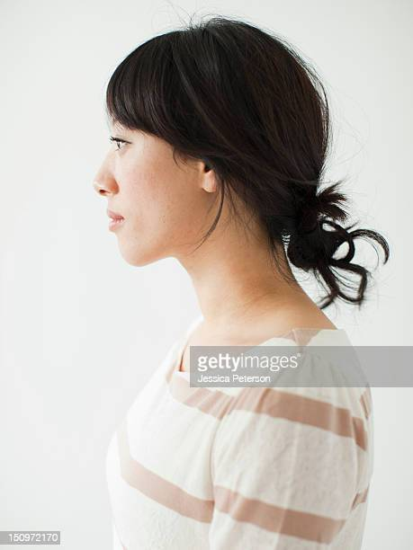 Side view of young woman, studio shot
