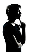 one caucasian young teenager silhouette boy or girl thinking portrait in studio cut out on white background