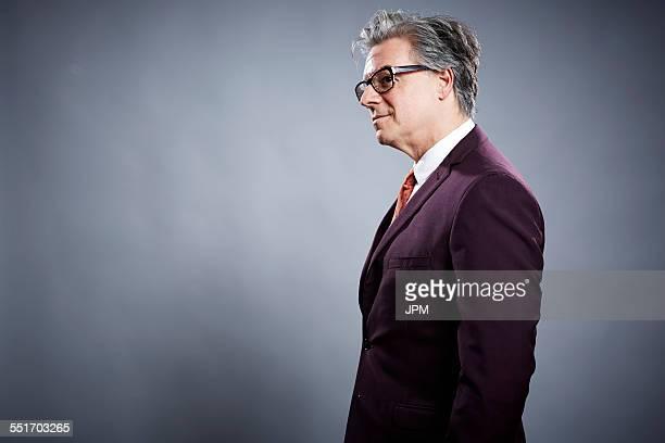 Side view studio portrait of businessman