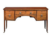 Antique bow fronted mahogany sideboard with brass lion handlesisolated on white with clipping path