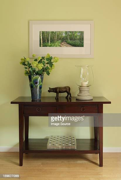 Sideboard with ornaments and vase