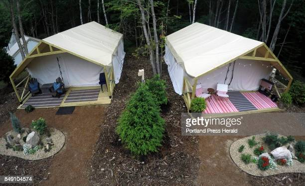 Sidebyside glamping tents at Sandy Pines Campground in Kennebunkport come with porch seating ice chests and manicured ornamental gardens