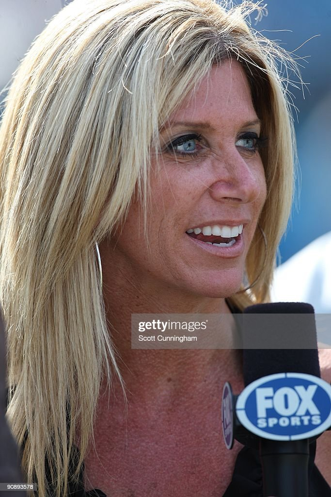 Sideline announcer Laura Okmin gives a report during the game between the Carolina Panthers and the Philadelphia Eagles at Bank Of America Stadium on September 13, 2009 in Charlotte, North Carolina.