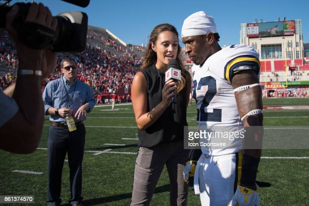 ESPN sideline reporter Allison Williams interviewing Michigan Karan Higdon following a college football game between the Michigan Wolverines and the...