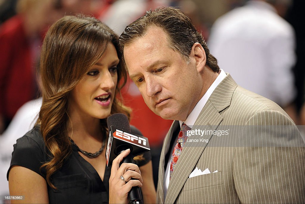 ESPN sideline reporter Allison Williams (L) interviews Head Coach Mark Gottfried of the North Carolina State Wolfpack during a game against the Virginia Tech Hokies during the first round of the 2013 Men's ACC Tournament at the Greensboro Coliseum on March 14, 2013 in Greensboro, North Carolina. NC State defeated Virginia Tech 80-63.