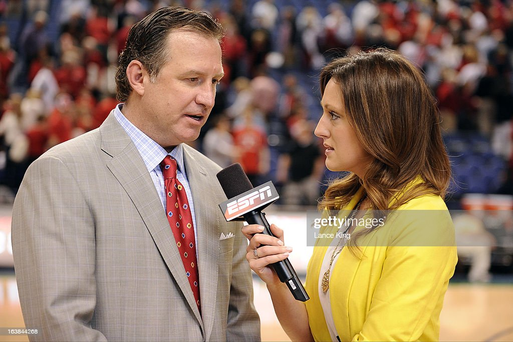 ESPN sideline reporter Allison Williams (R) interviews Head Coach Mark Gottfried of the North Carolina State Wolfpack following a game against the Virginia Cavaliers during the quarterfinals of the 2013 Men's ACC Tournament at the Greensboro Coliseum on March 15, 2013 in Greensboro, North Carolina. NC State defeated Virginia 75-56.