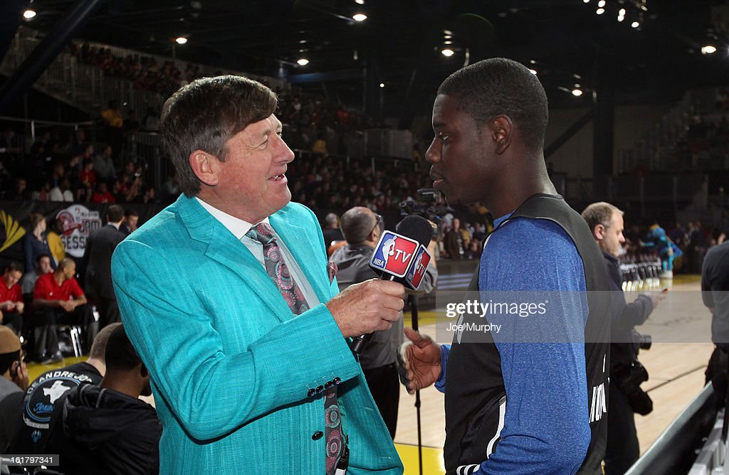 TNT sideline reporter Craig Sager interviews Jrue Holiday of the Philadelphia 76ers during the NBA AllStar Practice in Sprint Arena during the 2013...
