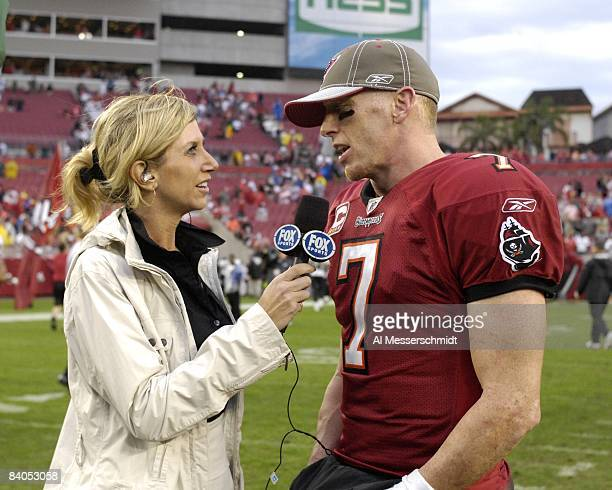 FOX sideline reporter Laura Okmin talks with Quarterback Jeff Garcia of the Tampa Bay Buccaneers after play against the New Orleans Saints at Raymond...