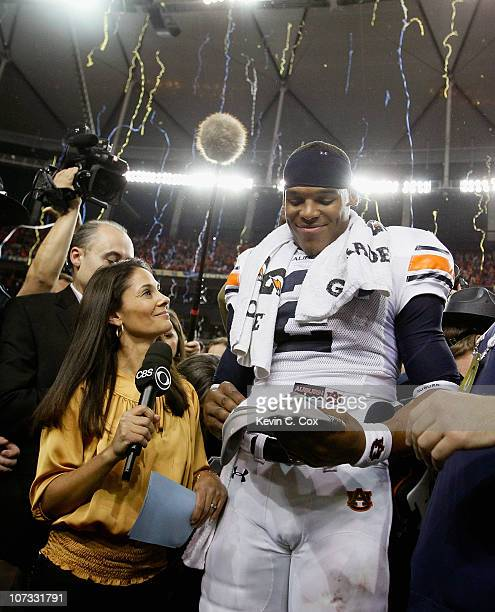CBS sideline reporter Tracy Wolfson waits for an interview as quarterback Cam Newton of the Auburn Tigers celebrates after their 5617 win over the...