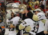 Sideny Crosby Petr Sykora and Evgeni Malkin of the Pittsburgh Penguins hold the Stanley Cup following the Penguins victory over the Detroit Red Wings...