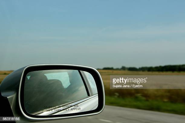 Side-View Mirror Against Sky