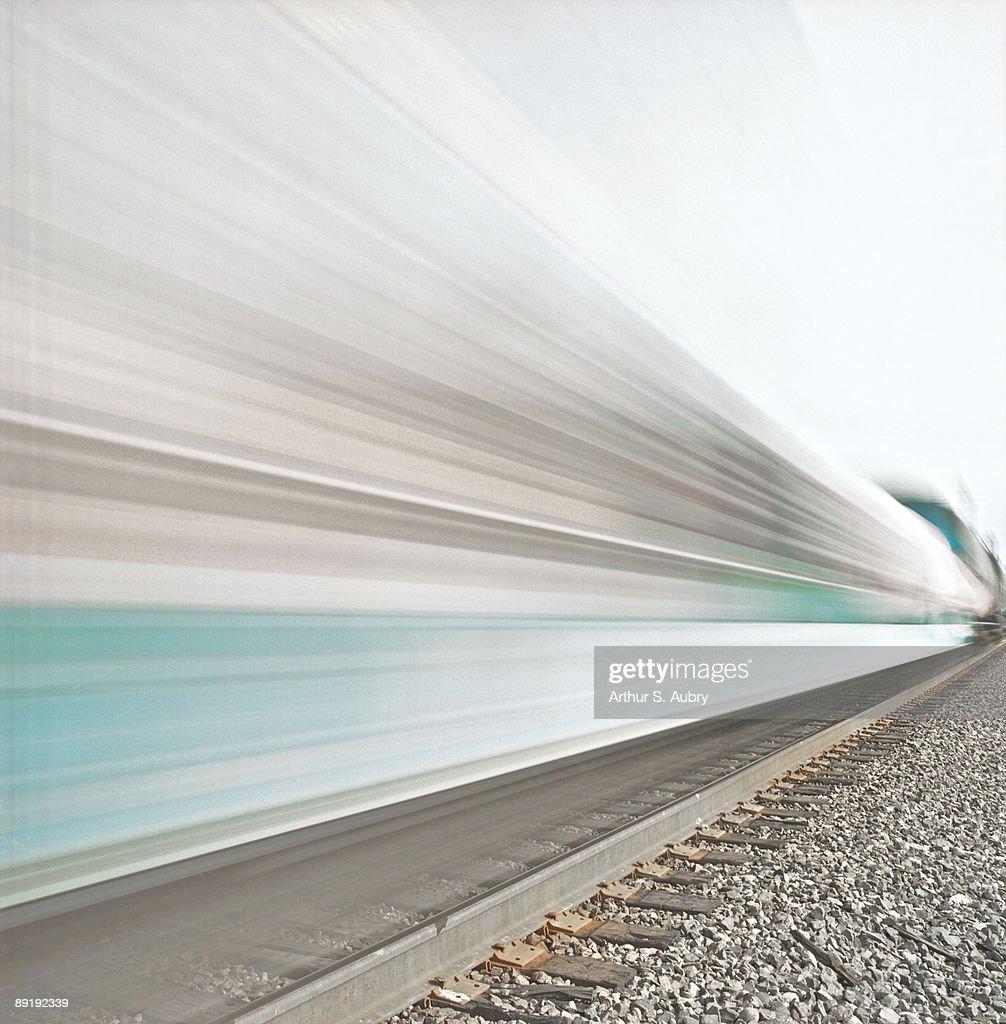 Side-view of speeding train : Stock Photo