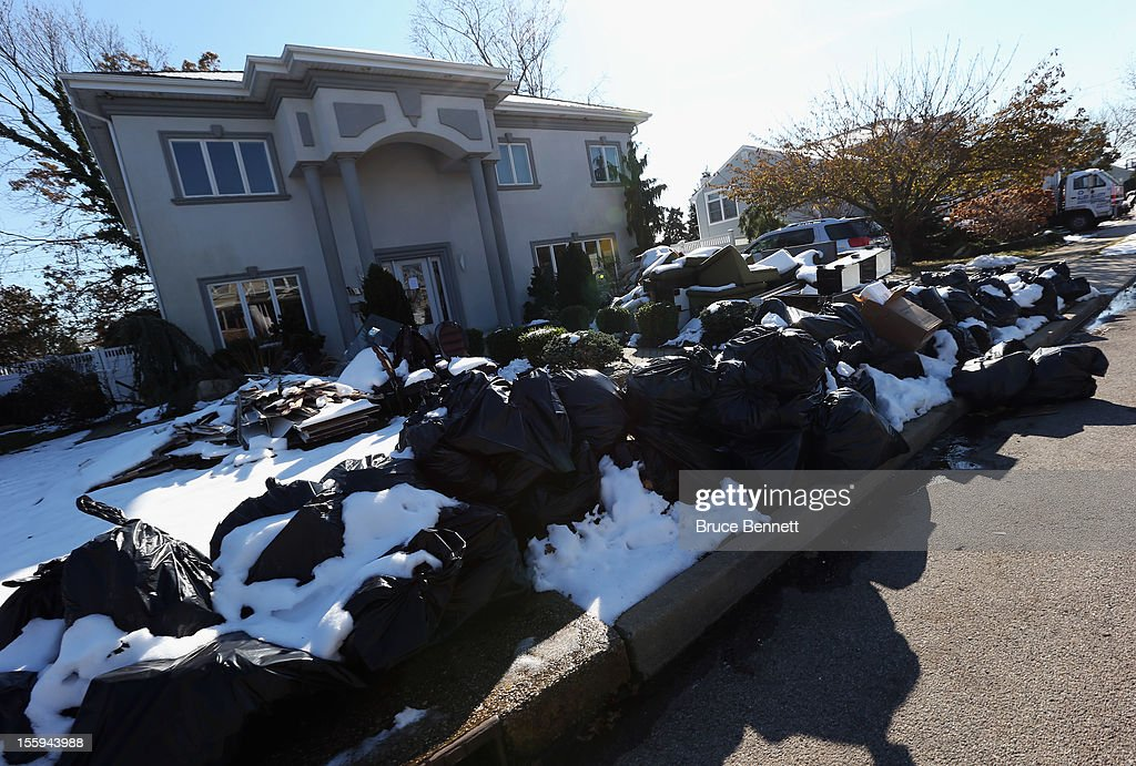 A sidewalk on Beverley Road is littered with garbage bags filled with contents from a flooded home in the aftermath of Superstorm Sandy on November 9, 2012 in Merrick, New York. New York Gov. Andrew M. Cuomo has said that the economic loss and damage to homes and businesses caused by Sandy could total $33 billion in New York, according to published reports.