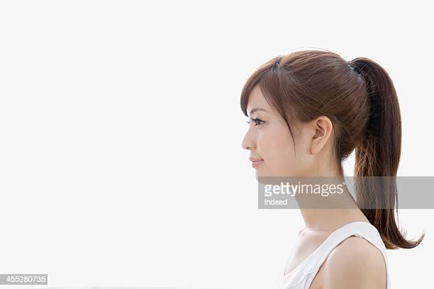 Sideways-facing of woman dressed in tank top