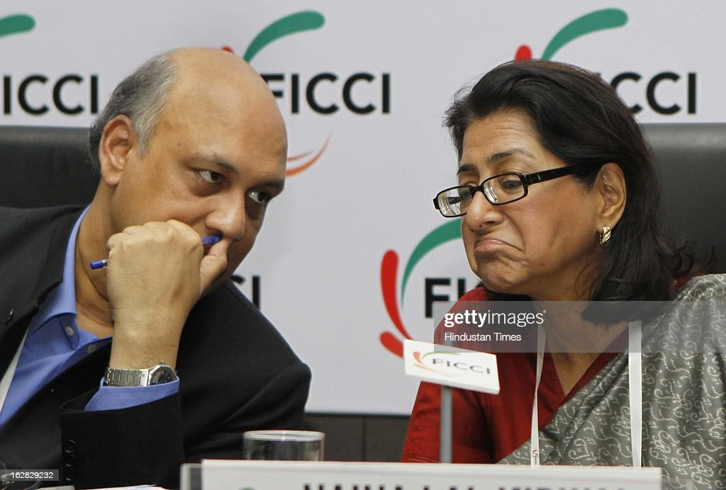 , Sidharth Birla and Naina Lal Kidwai react during the direct telecast of the Union Budget 2013-14 during Industry - Media Interface on Union Budget Session 2013-14 at Federation House, FICCI on February 28, 2013 in New Delhi, India. India Inc gave a thumbs up to the UPA-II's last Union Budget before the general elections next year.