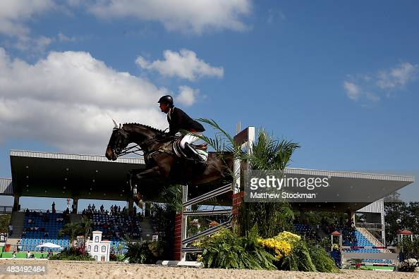 Sidnei de Souza of Brazil riding Honorat competes in Jumping during the Eventing Individual competition at the Olympic Equestrian Center at Deodoro...