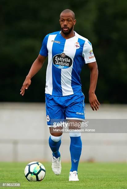 Sidnei Rechel of Deportivo de La Coruna runs with the ball during the preseason friendly match between Cerceda and Deportivo de La Coruna at O Roxo...