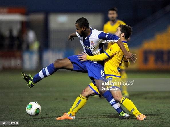 Sidnei Rechel of Espanyol shields the ball from Juan Fuentes of AD Alcorcon during the Copa del Rey Round of 16 1st leg match between Alcorcon and...
