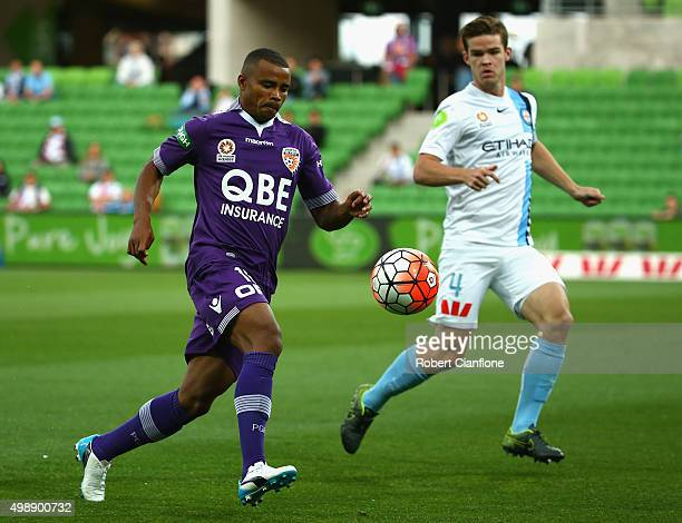 Sidnei Sciola of Perth Glory is chased by Connor Chapman of Melbourne City during the round eight ALeague match between Melbourne City FC and Perth...