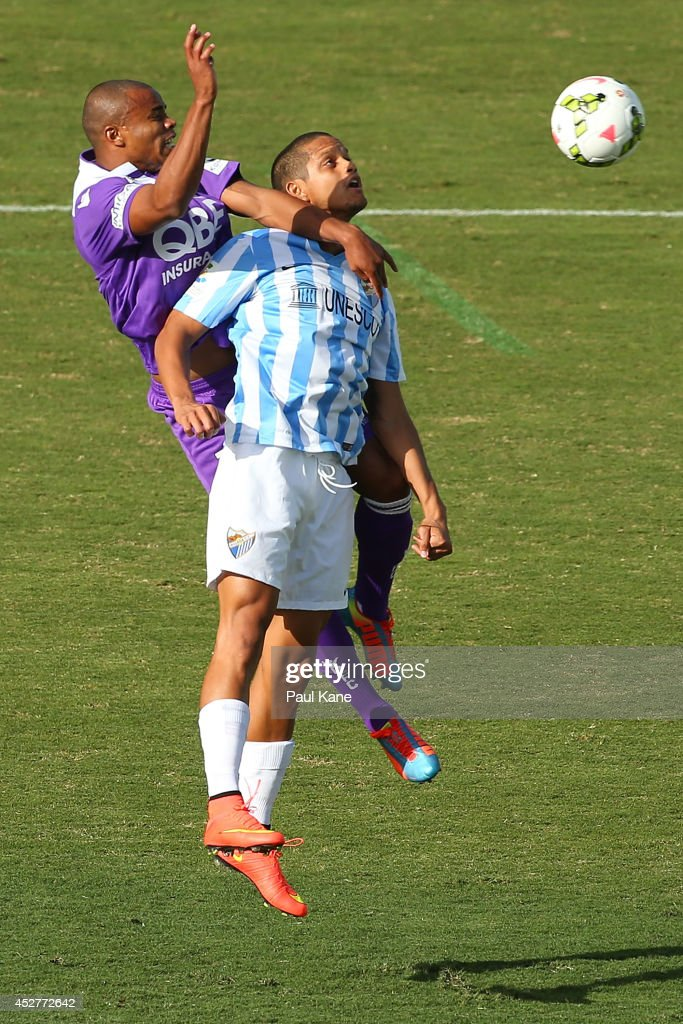 Sidnei Sciola of the Glory and Rosales of Malaga contest for the ball during the International Club friendly match between Malaga CF and Perth Glory...