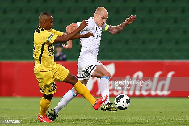 Sidnei Sciola of the Glory challenges Aaron Mooy of Melbourne during the FFA Cup Semi Final match between Perth Glory and Melbourne City FC at nib...