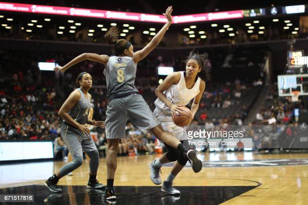 Sidney Cooks Michigan State defended by Maya Dodson Stanford during the Jordan Brand Classic National Girls Team AllStar basketball game at The...
