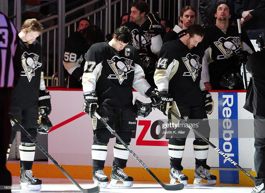 Sidney Crosby #87 and Brooks Orpik #44 of the Pittsburgh Penguins stand during the National Anthem before the game against the Philadelphia Flyers at Consol Energy Center on February 20, 2013 in Pittsburgh, Pennsylvania.