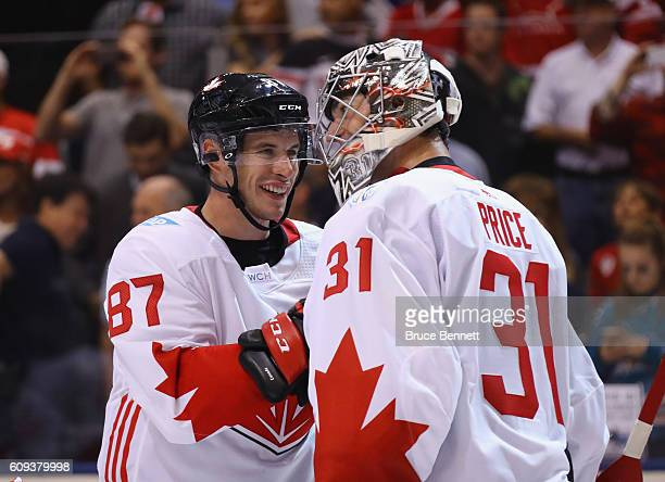 Sidney Crosby and Carey Price of Team Canada celebrate a 42 victory over Team USA during the World Cup of Hockey tournament at the Air Canada Centre...