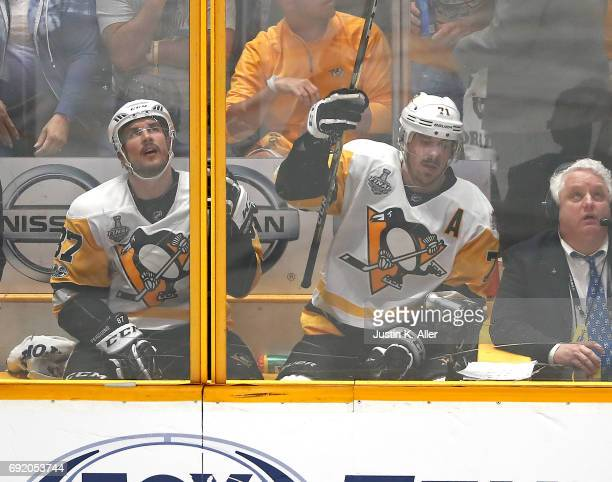 Sidney Crosby and Evgeni Malkin of the Pittsburgh Penguins both sit in the penalty box against the Nashville Predators during the third period in...