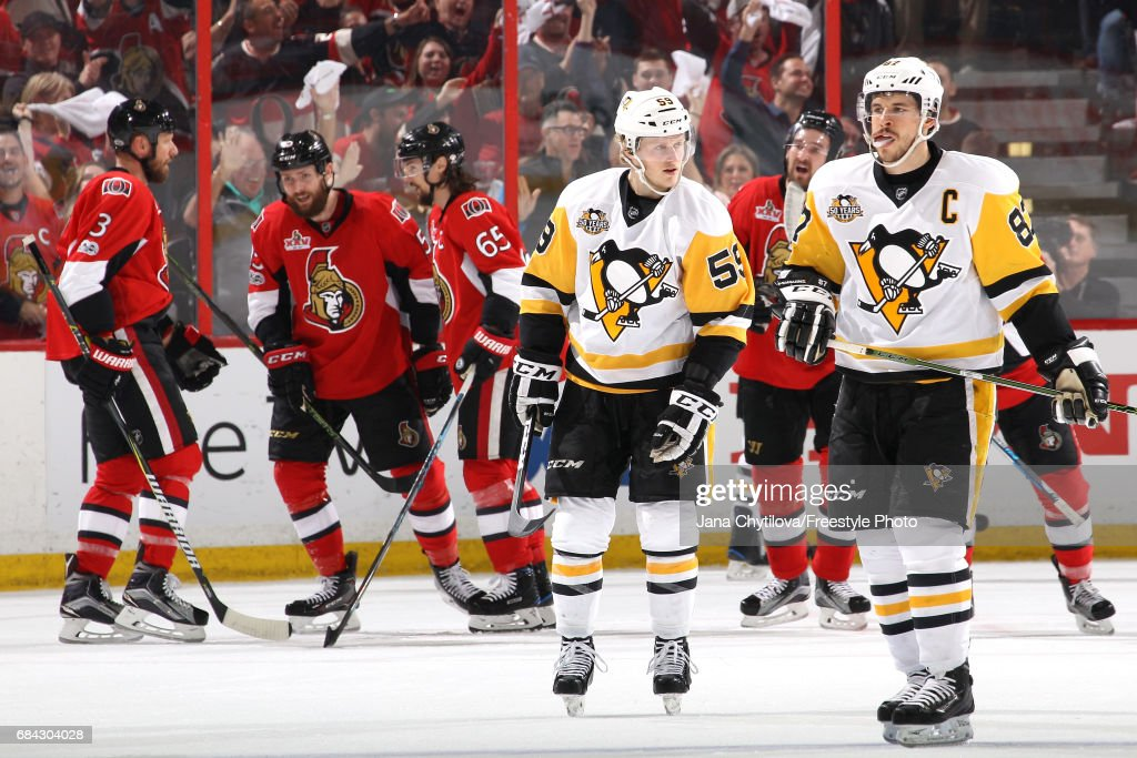 Sidney Crosby #87 and Jake Guentzel #59 of the Pittsburgh Penguins react after the fourth goal scored by Ottawa Senators during the first period in Game Three of the Eastern Conference Final during the 2017 NHL Stanley Cup Playoffs at Canadian Tire Centre on May 17, 2017 in Ottawa, Canada.