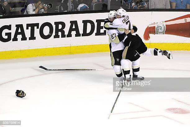 Sidney Crosby and Matt Cullen of the Pittsburgh Penguins celebrate after the Penguins celebrate after their 31 victory to win the Stanley Cup against...