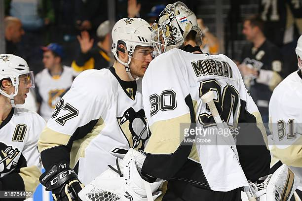 Sidney Crosby and Matt Murray of the Pittsburgh Penguins celebrate their win against the New York Islanders at the Barclays Center on April 2 2016 in...
