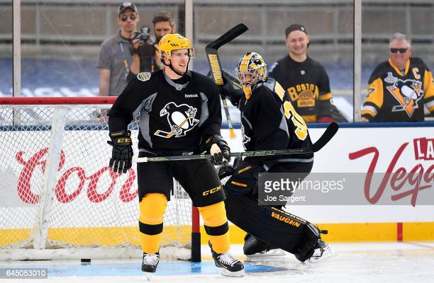 Sidney Crosby and Matt Murray of the Pittsburgh Penguins skate during practice at Heinz Field on February 24 2017 in Pittsburgh Pennsylvania