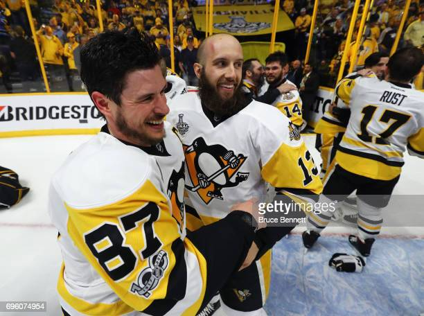 Sidney Crosby and Nick Bonino of the Pittsburgh Penguins celebrate their Stanley Cup winning victory over the Nashville Predators in Game Six of the...