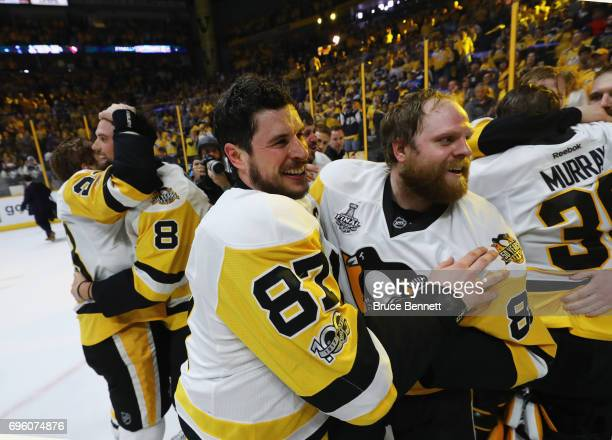 Sidney Crosby and Phil Kessel of the Pittsburgh Penguins celebrate their Stanley Cup winning victory over the Nashville Predators in Game Six of the...