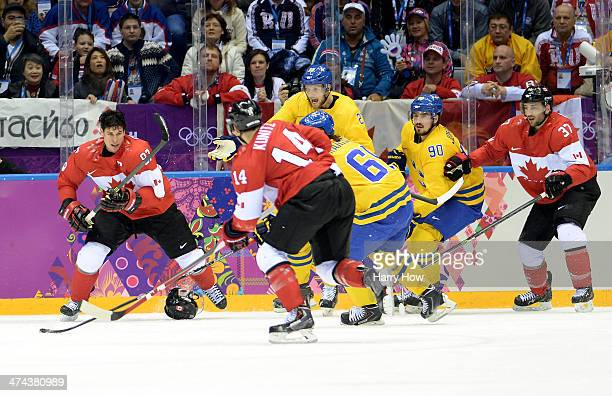 Sidney Crosby Chris Kunitz and Patrice Bergeron of Canada compete for the puck with Alexander Edler Erik Karlsson and Marcus Johansson of Sweden...