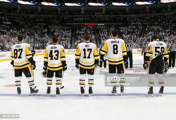 Sidney Crosby Conor Sheary Bryan Rust Brian Dumoulin and Kris Letang of the Pittsburgh Penguins stand on the ice during the singing of the National...