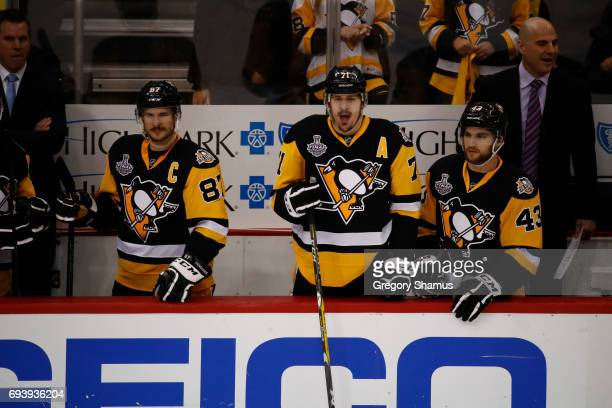 Sidney Crosby Evgeni Malkin and Conor Sheary of the Pittsburgh Penguins look on from the bench against the Nashville Predators during the third...
