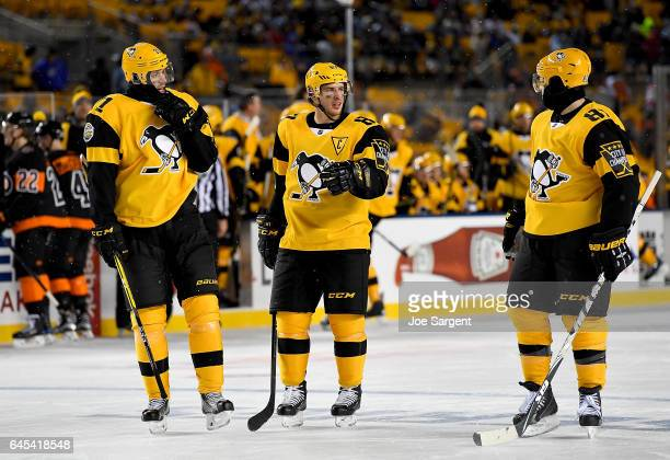 Sidney Crosby Evgeni Malkin and Phil Kessel of the Pittsburgh Penguins talk during a timeout against the Philadelphia Flyers during the 2017 Coors...