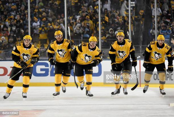 Sidney Crosby Ian Cole Jake Guentzel Justin Schultz and Scott Wilson of the Pittsburgh Penguins skate toward the bench after celebrating Crosby's...